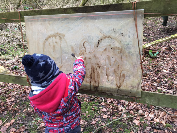Mud painting at Forest School at Rendcomb College