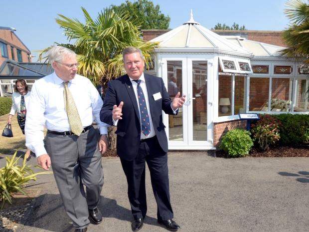 Gary Jones, showing the Duke of Gloucester around Glevum Windows.